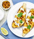 Roasted chickpeas stuffed sweet potato with Greek yogurt cilantro lime dressing. toning. selective focus