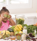 Fun games of a daughter hide and seek with kiwi fruit in the kitchen.