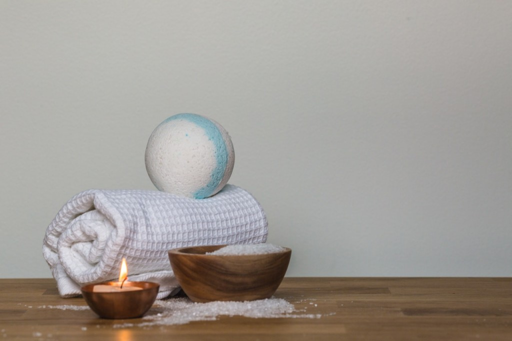 photo-of-towel-and-bath-bomb-near-candle-374071