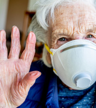 Close-Up Shot of Elderly Senior Caucasian Woman's Eyes Wearing an n95 Protective Face Mask To Prevent the Spread of COVID SARS nCoV 19 Coronavirus Swine Flu H7N9 Influenza Illness During Cold and Flu Season
