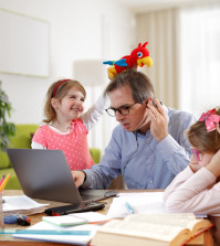 Caos - Father And Schoolgirl Working At Home - Telework And E-Learning